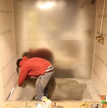 Bathroom Update- Metal Panels and Colored Concrete Walls